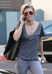 90210 star AnnaLynne McCord was caught outside chatting on her phone, while carrying a black studded tote. Her bag was definitely the stand out piece of her all grey outfit.
