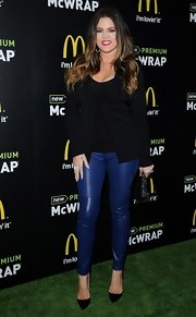 As if leather pants didn't already make a statement, Khloe Kardashian chose an electric blue pair for her red carpet look.