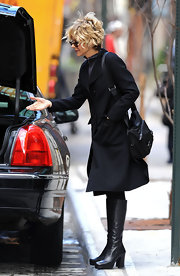 Meg showed off her city style while in New York. She paired her knee-high boots with a cozy trench coat.