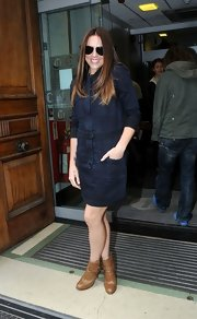 Mel C paired tan ankle boots with a denim dress for a totally stylish look while visiting BBC.