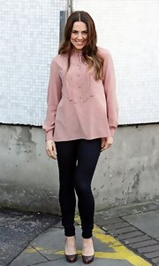 Mel C looked feminine in London in a pink tuxedo-style tunic and skinny jeans.
