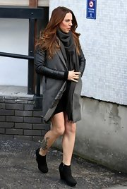 Mel C toughened her winter wear with a leather-sleeved coat.
