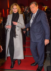 Melanie Griffith kept warm with a gray wool coat and a fringed black scarf for her visit to Lugner Kino City.