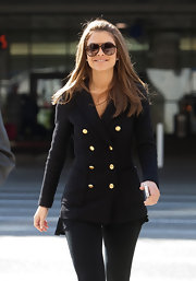 Maria Menounos kept things simple in a sleek navy coat with gold military buttons.