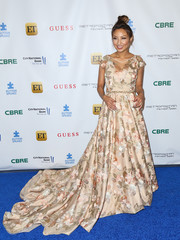 Jeannie Mai channeled her inner princess with this floral fishtail gown for the La Vie En Bleu event.