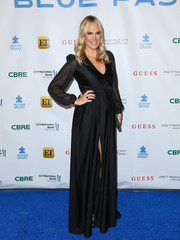 Elegant expectant mom Molly Sims chose a black maxi dress with sheer sleeves and a high slit for the La Vie En Bleu event.