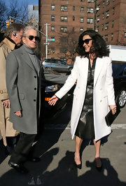 Catherine was all class at Fashion Week in a long white wool coat over a leather button-down dress.