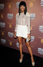 Brandy topped off her white hot ensemble with platform pumps.