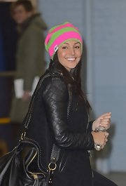 Michelle Keegan added some color to her winter look with this pink and green striped beanie.