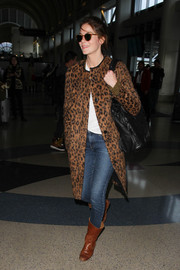 Michelle Monaghan showed off her wild side in a leopard print coat while catching a flight at LAX.