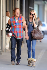 Mickey Rourke and his girlfriend Anastassija were out and about in the meatpacking district shopping. She showed off her casual style and a cute brown leather tote bag.