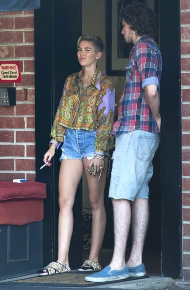 Miley Cyrus Slide Sandals Are The Summer Footwear Trend We Can't Get Enough Of
