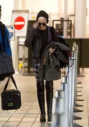 Miley Cyrus is never afraid to show her rocker edge like with these front-zip knee high boots.