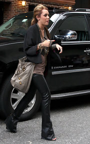 Miley Cyrus carried a slouchy leather bag in a muted mushroom hue.