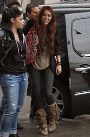 "Miley wore a $1,160 pair of ""Dana Fringed Canvas Boots"" with dark skinny jeans and a army green top. The boho shoes complemented her colorful shoulder bag."