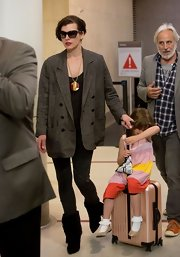 Milla Jovovich toughened up her airport ensemble with this mens blazer.