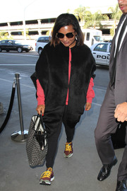 For her travel bag, Mindy Kaling chose a classic Goyard tote.