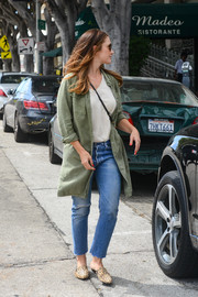 Minka Kelly topped off her outfit with an oversized military jacket.