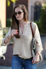 Minka Kelly exuded effortless elegance in a silky sand blouse.