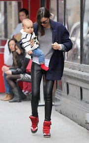 Miranda Kerr took a stroll with her darling son in a pair of leather leggings and an oversize navy blazer.