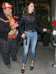 Miranda Kerr was spotted outside Catch carrying a stylish tasseled shoulder bag by Saint Laurent.