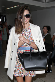 Miranda Kerr topped off her airport look with oversized cateye sunnies by Chanel.