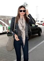 Miranda Kerr wore a gauzy patterned scarf to the airport.