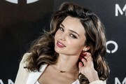 Miranda Kerr strikes several poses as she is announced as the new face of the Mango clothing line.