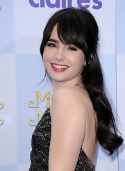 Lily Collins wore her hair half up with long wavy lengths and lash-grazing bangs at the premiere of 'Mirror Mirror.'