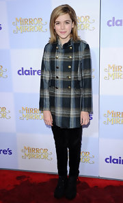 Kiernan bundled up in a plaid tartan wool coat.