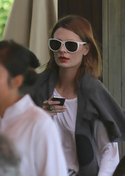Mischa Barton wore a pair of white oversize shades paired with vibrant red lipstick while out having lunch in South Beach.