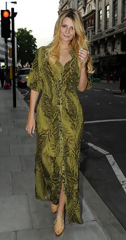 Mischa donned a green tropical print button-down dress while out to a restaurant.