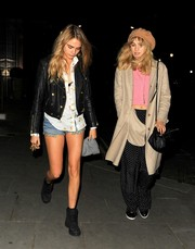 Suki Waterhouse teamed a nude wool coat with a pink crop-top and print pants for a night out in Chelsea.