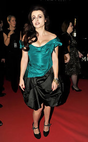 Helena Bonham Carter looked quite polished in a pair of black suede pumps with flower-embellished ankle straps.