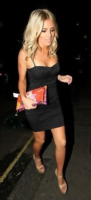Mollie King showed off her fit figure with this fitted black dress.