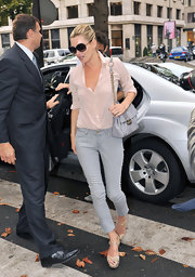 "Kate's glamorous grey stamped leather ""Stingray Bag"" is a stylish way to complete a professional ensemble."