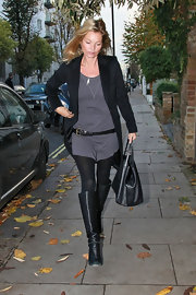 Kate Moss belted a charcoal tunic under one of her favorite toppers, a black boyfriend blazer.