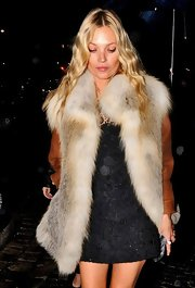 Kate Moss left the Ritz Hotel in Paris wearing her long wavy hair casually tousled.
