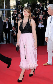 Eve Hewson wowed during the Cannes Film Festival in an intricate two-tone halter dress. The tea-length dress featured a black sequined bodice over sheer mesh trim, while the cream silk skirt revealed a hint of tulle.