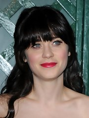 Zooey Deschanel kept her clothing neutral but still played around with color at the 'My Valentine' video premiere by sweeping on a pearly shade of raspberry lipstick.