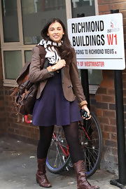 Naomi Scott trekked through London in a sharp brown blazer with black lapels and rolled sleeves.