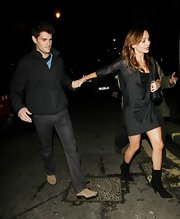 Natalie Imbruglia went clubbing in London wearing a sheer blouse, a mini skirt, and pointy black mid-calf boots.