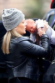 Natalie Bassingthwaighte was spotted out with her baby wearing a gray knit beanie.