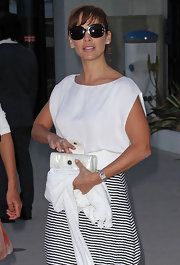 Natalie Imbruglia finished off her chic Cannes ensemble with a pair of butterfly sunnies.