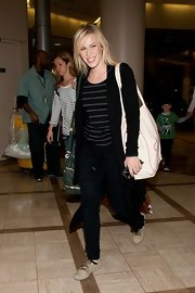 Natasha Bedingfield strode through LAX wearing a casual pair of tan lace-up shoes.