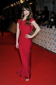 Lily James brought the glamour to the National Television Awards in this floor-length red gown that wrapped around her ankles in a Grecian manner.