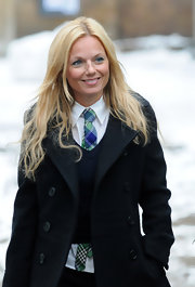 This preppy, plaid, blue and green tie matches Geri's makeup and adds color to her school girl ensemble.