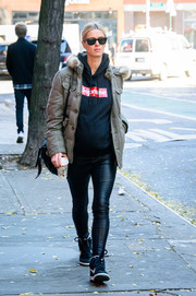 Nicky Hilton amped up the sporty feel with a pair of basketball sneakers by Nike.