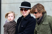 Nicole wears a stylish felt Chaplin hat while out with her family.