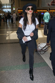Nicole Scherzinger teamed her shirt with black skinny jeans.